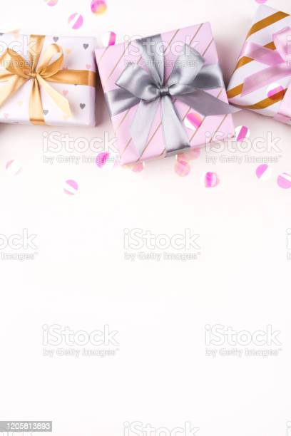 Gift boxes with bows and confetti on a white background picture id1205813893?b=1&k=6&m=1205813893&s=612x612&h=1ezce butplche2v71jxnrtjxfk5fhg7ejtqx9fskaw=