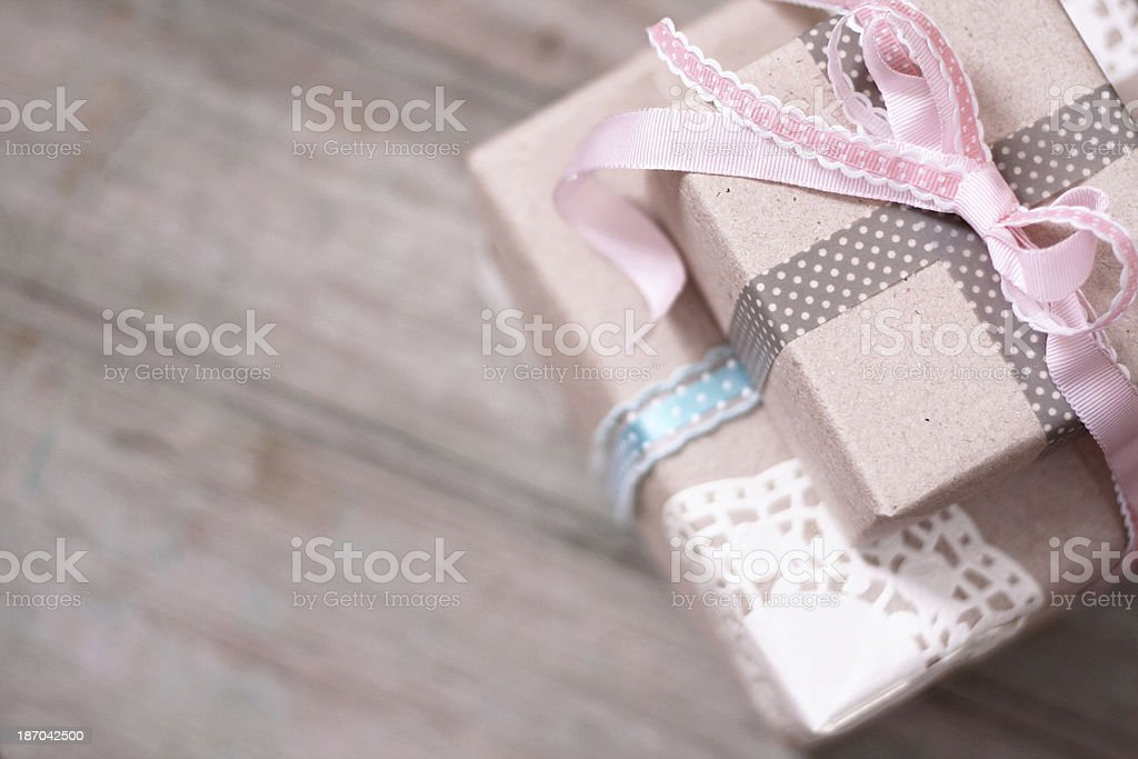 Gift boxes with brown paper directly above on wood royalty-free stock photo
