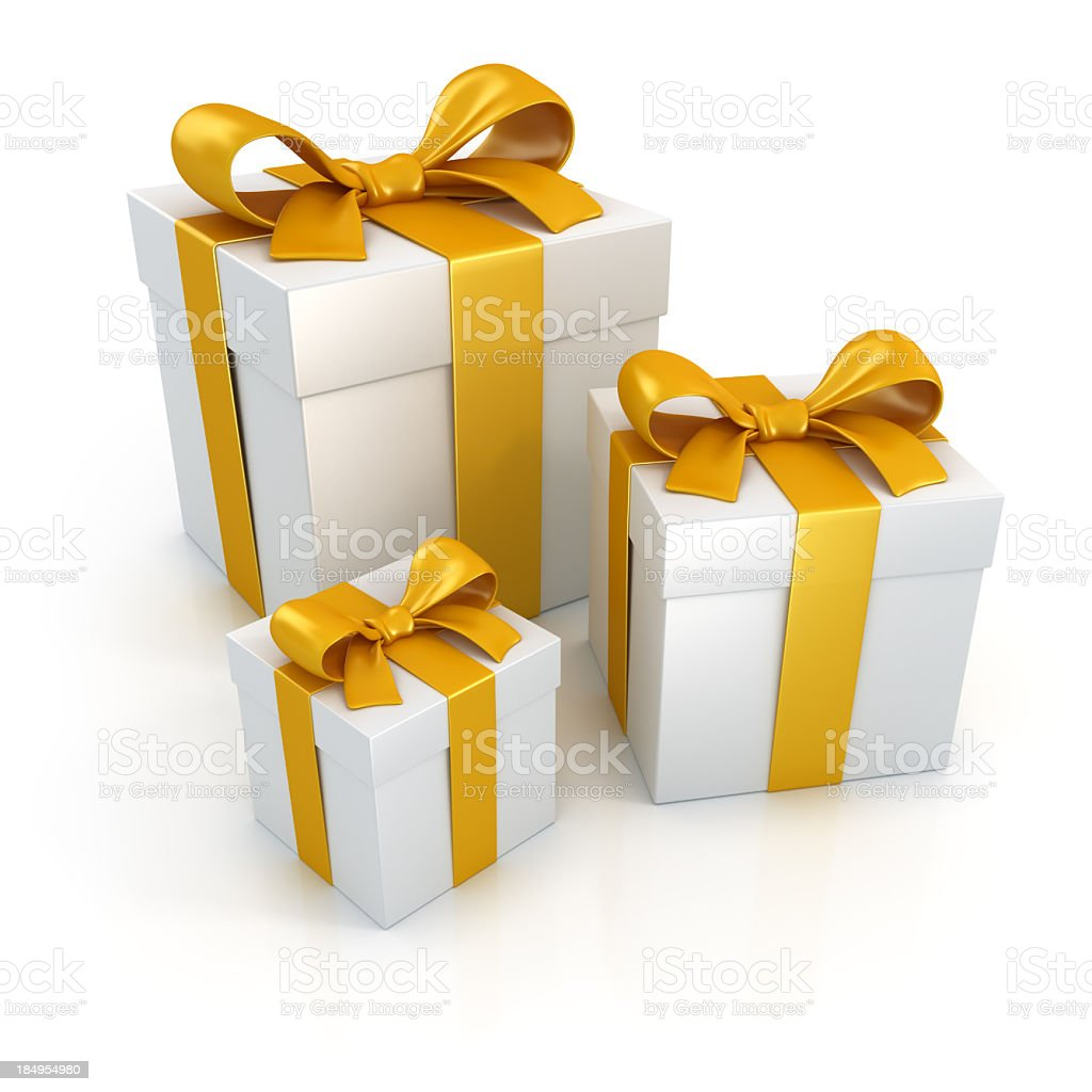 Gift boxes with gold ribbons isolated on white stock photo