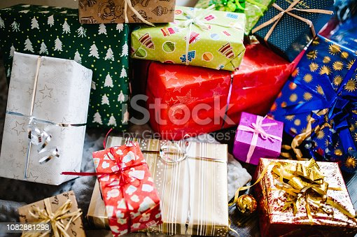 istock Gift boxes with ornaments on gray knitted background. space for text, design. Happy Holidays. top view. flat lay. stylish wrapped gifts. merry christmas, new year concept. birthday. Valentine's day. 1082881298