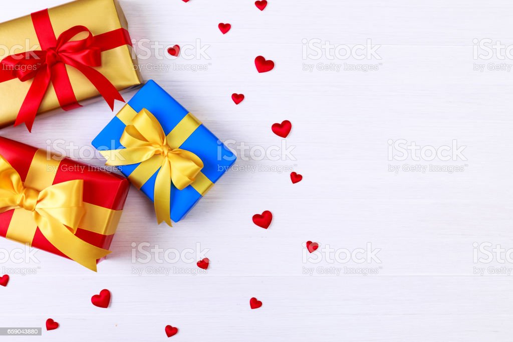 Gift boxes with red hearts. Present packages. royalty-free stock photo