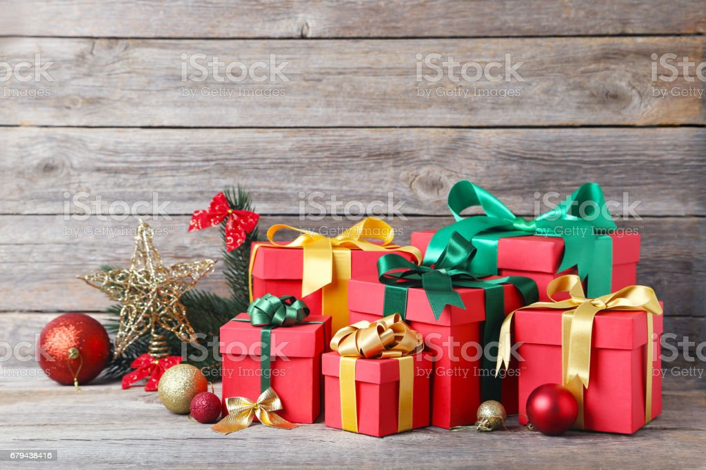 Gift boxes with ribbon on grey wooden table royalty-free stock photo