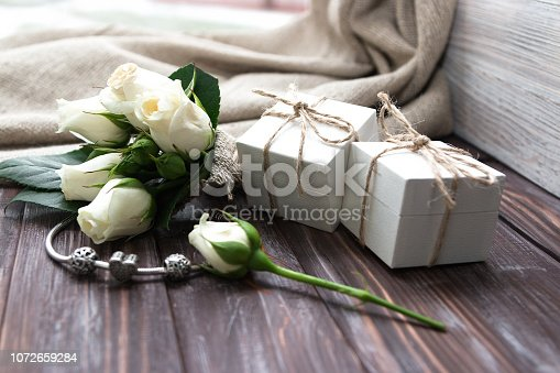 istock Gift boxes with silver bracelet and charms. 1072659284