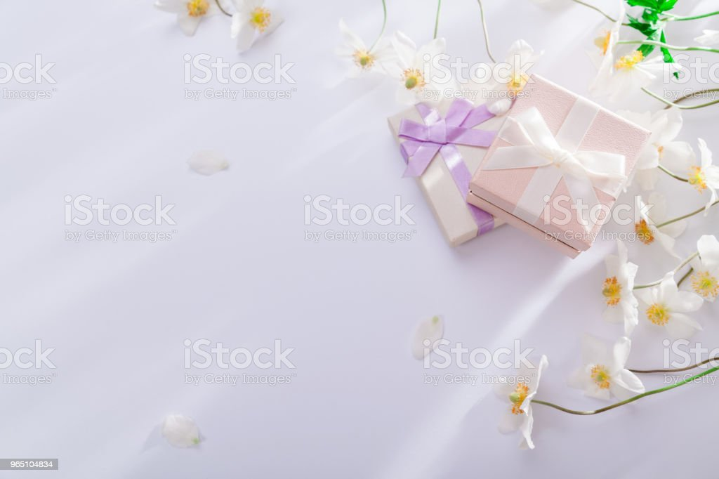 Gift boxes with white flowers on white background. Copy space zbiór zdjęć royalty-free
