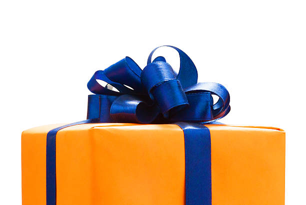 gift boxes wrapped in orange paper. - birthday gift stock photos and pictures