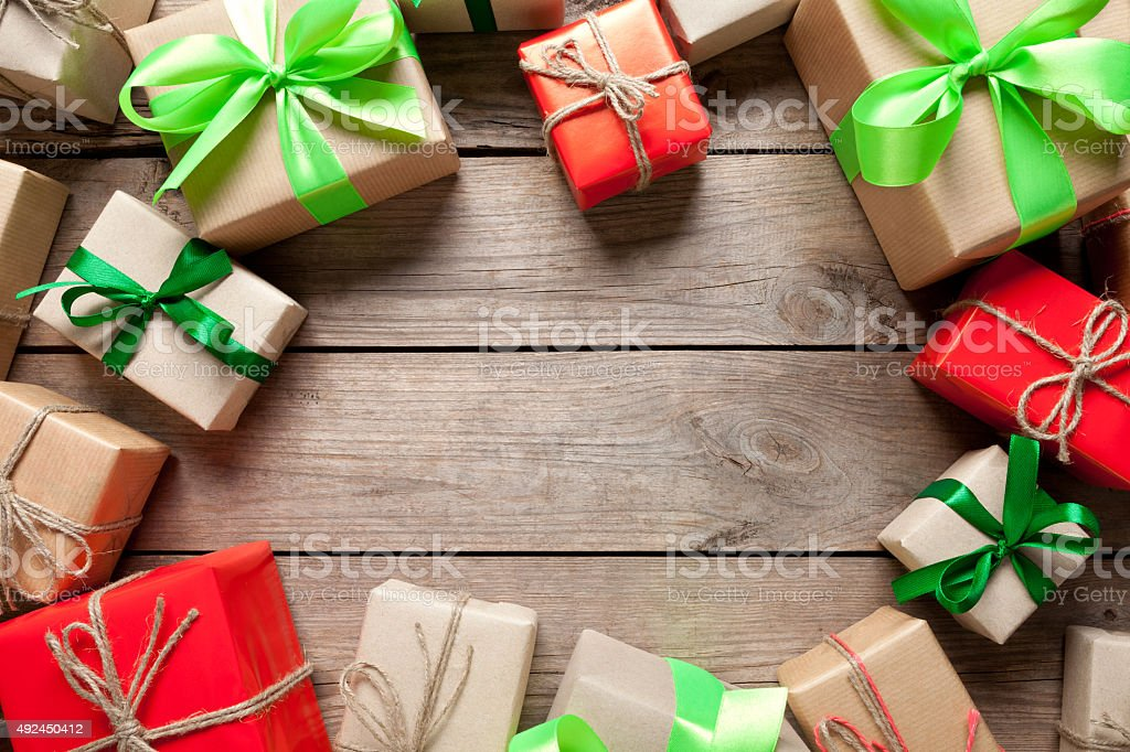 Gift boxes wrapped in paper on wooden table stock photo