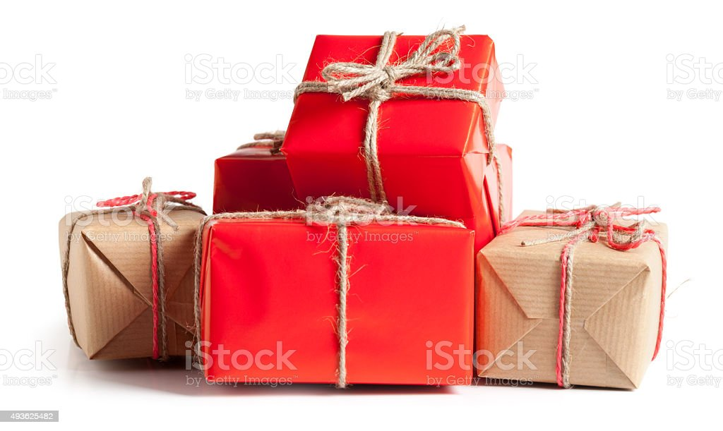 Gift boxes wrapped in paperr on white stock photo