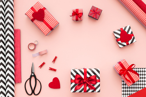 Gift Boxes Wrapped In Red Checked Paper On Pink Background Stock Photo - Download Image Now