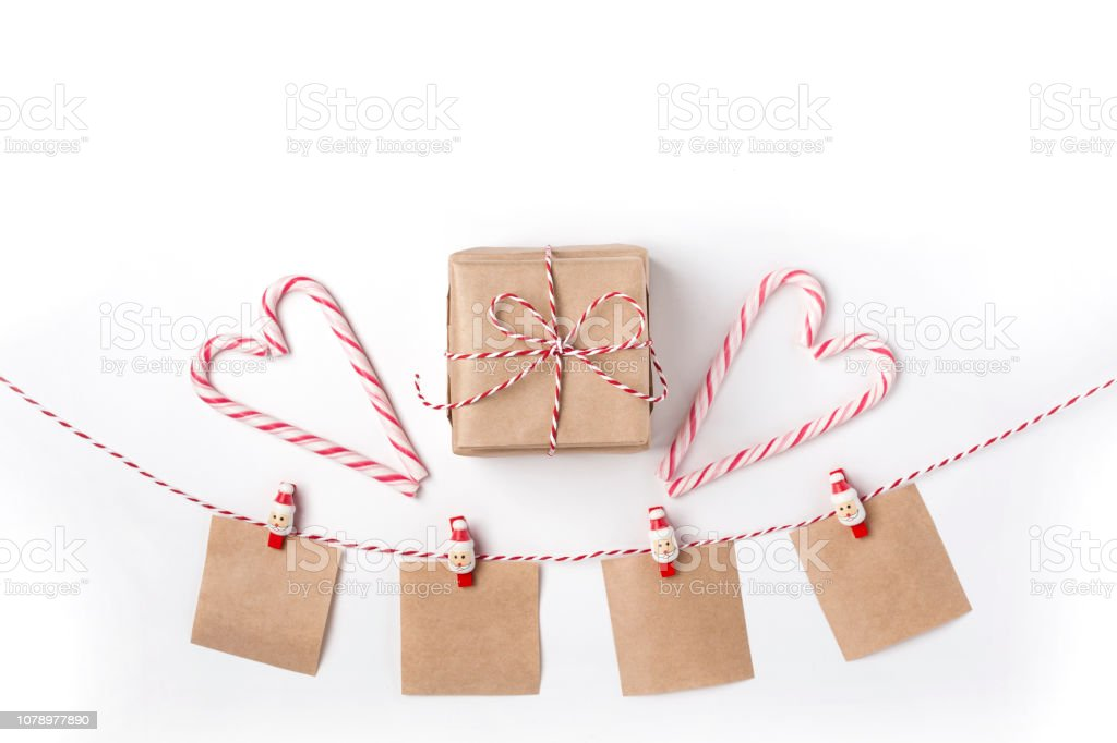 Gift, candles, lollipops, notes with wish on clothespins, Top view White Background Christmas New Year stock photo