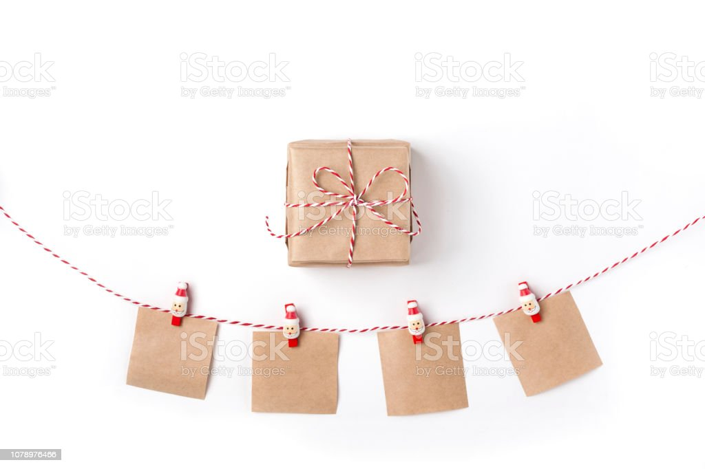 Gift, candles, notes with wish on clothespins, Top view White Background Christmas New Year stock photo