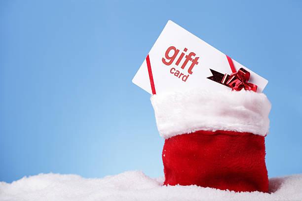 geschenkkarte in santa's sack - gutschein weihnachten stock-fotos und bilder
