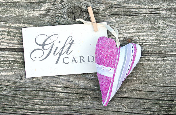 Gift card in white with a cloth heart​​​ foto