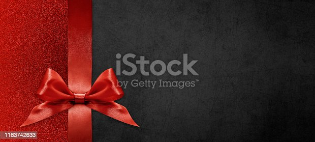 670414478 istock photo gift card wishes merry christmas background with red ribbon bow on black shiny vibrant color texture template with blank copy space 1183742633