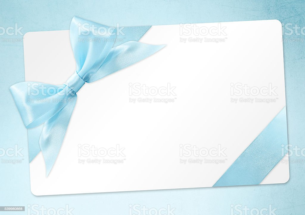gift card with blue ribbon bow Isolated on azure background stock photo