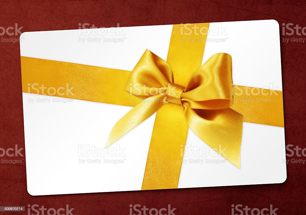 gift card with golden ribbon bow Isolated on red background stock photo