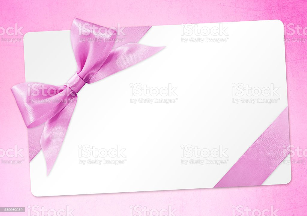 gift card with pink ribbon bow Isolated on pink background stock photo