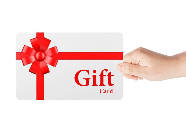 geschenkgutschein mit roter schleife und bogen - sprüche zum firmenjubiläum stock-fotos und bilder