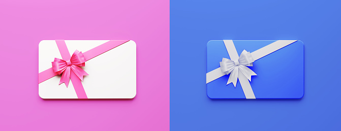 gift cards with bow ties over colored background stock
