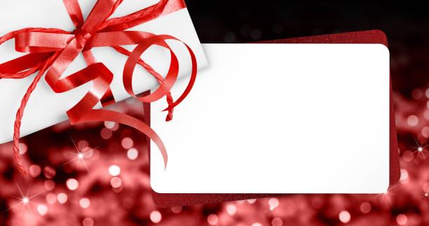 聖誕亮燈背景下的紅絲帶蝴蝶結禮品卡 - 情人節 節日 個照片及圖片檔