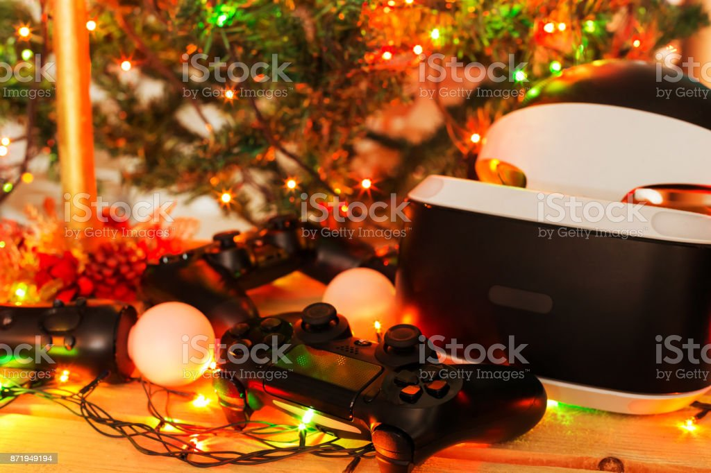 A gift for Christmas, New Year, St. Valentine's Day. A game console as a gift. Soft Focus Video Game Video Game Stock Photo