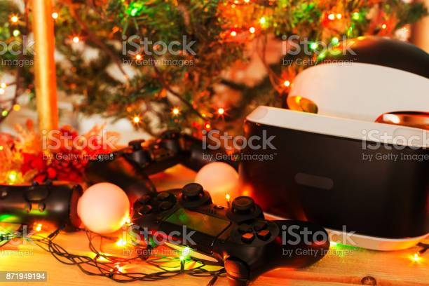 A Gift For Christmas New Year St Valentines Day A Game Console As A Gift Soft Focus Stock Photo - Download Image Now