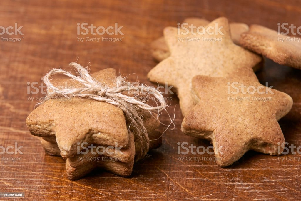 Gift for new year. Delicious dessert. Gingerbread stars stock photo
