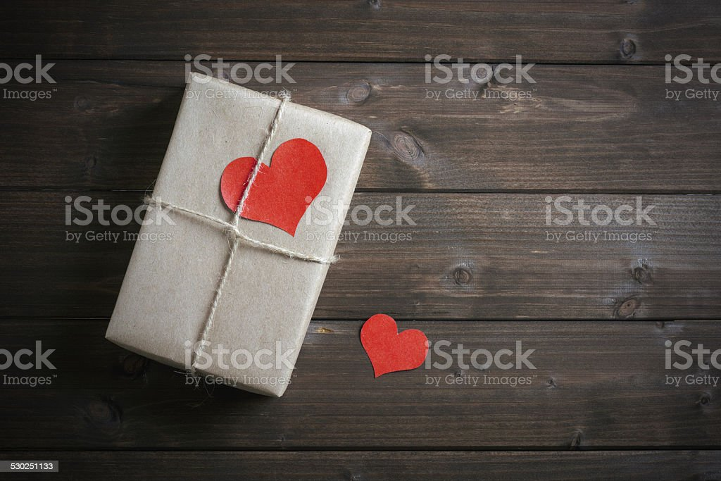 gift for Valentine's Day with red hearts stock photo