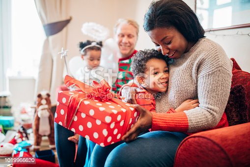 istock Gift Giving with his Mother at Christmas Time 1019966620