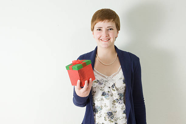 Gift giving woman stock photo