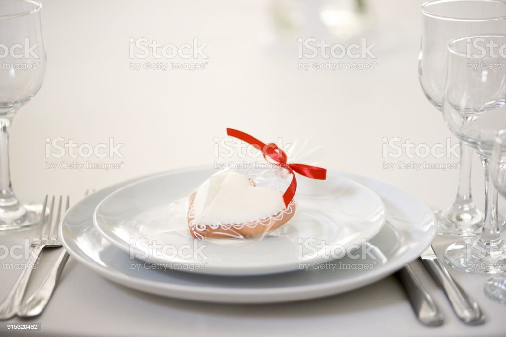 A gift glazed gingerbread heart stock photo