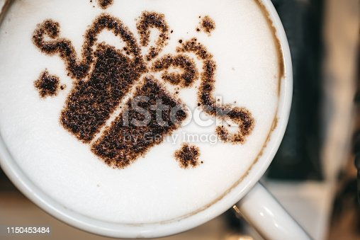 A small gift in a coffee, latte art.