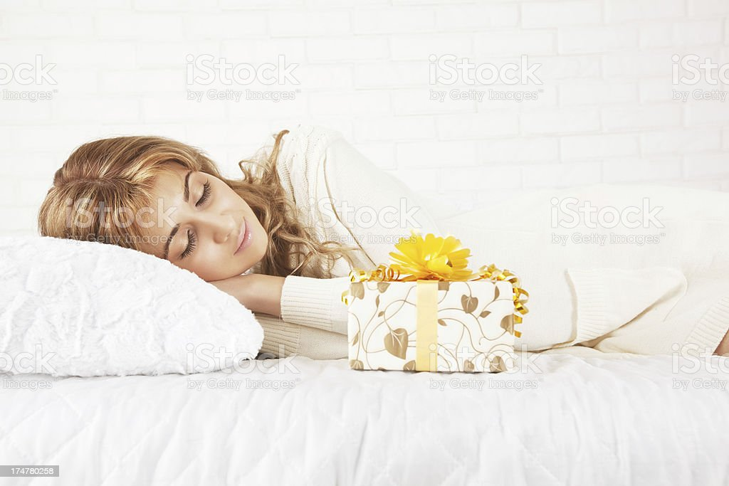 Gift in bed royalty-free stock photo