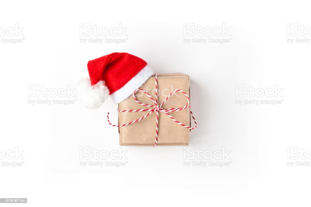 Gift in red hat santa claus Top view White Background, Christmas, New Year, Valentine day, Birthday stock photo