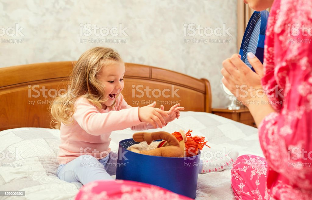 A gift in the box for a little girl. stock photo