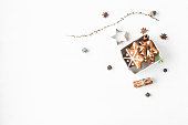 istock Gift, larch branches, cinnamon sticks, anise star, christmas cookies 617369874
