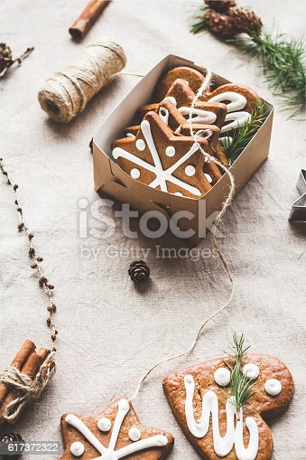 istock Gift, larch branches, cinnamon sticks, anise star, christmas cookies 617372322