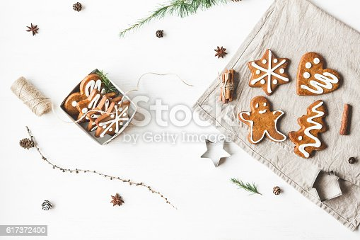istock Gift, larch branches, cinnamon sticks, anise star, christmas cookies 617372400