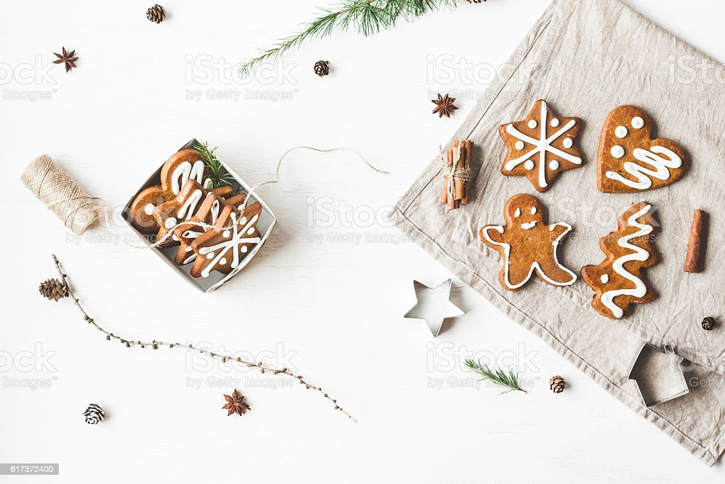 Gift, larch branches, cinnamon sticks, anise star, christmas cookies stock photo