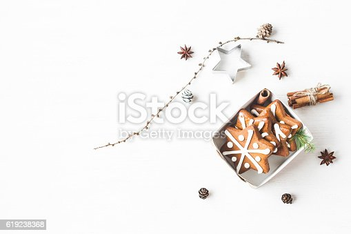 istock Gift, larch branches, cinnamon sticks, anise star, christmas cookies 619238368