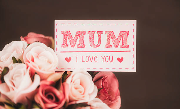 gift of flowers for mum on mother's day or birthday - i love you stock photos and pictures
