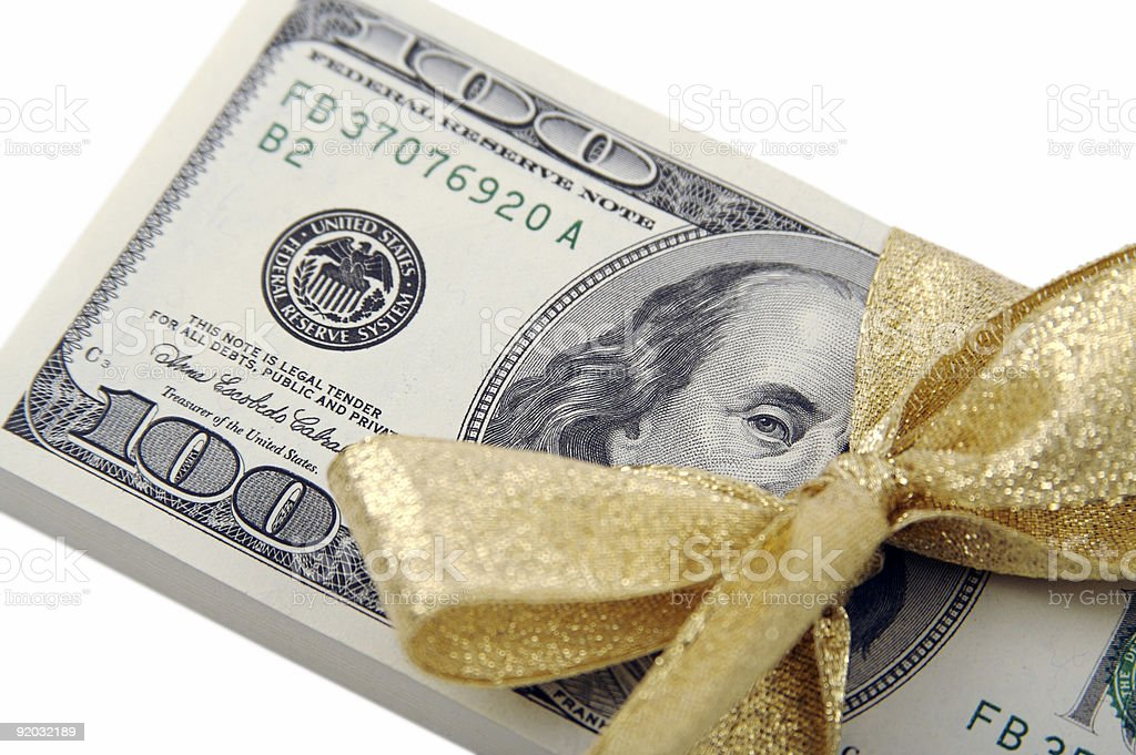 Gift of Hundreds with Gold Ribbon royalty-free stock photo