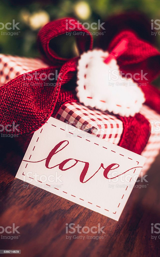Gift of love with flowers and heart shaped gift tag