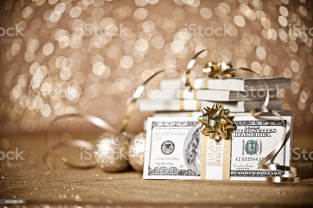 Gift of Money against a Defocused Background and Christmas Lights stock photo