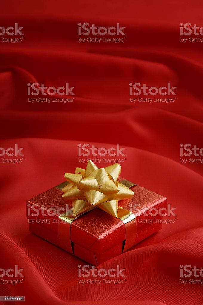 Gift on red background royalty-free stock photo