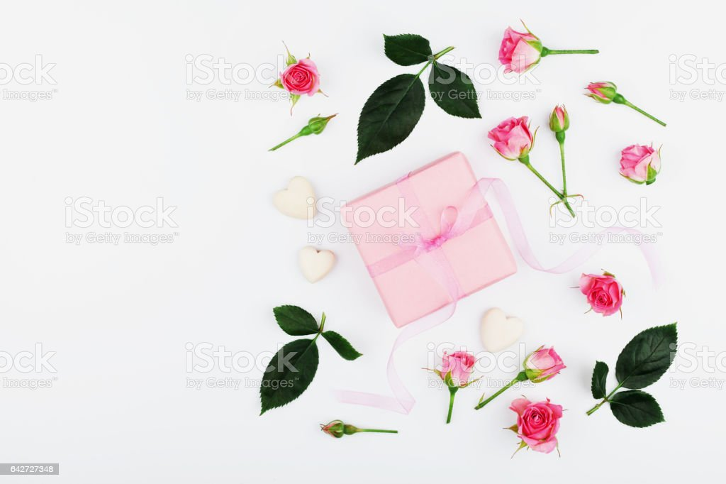 Gift or present box and pink rose flower. Greeting concept. stock photo