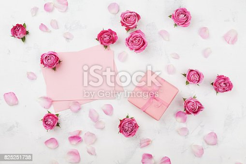 825251738 istock photo Gift or present box, envelope, paper blank, petals and pink rose flowers. Greeting card on Womans day concept. Flat lay. 825251738