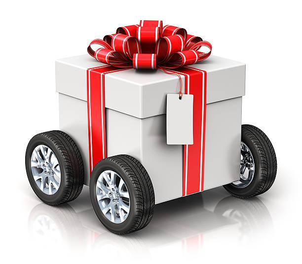gift or present box with car wheels - autoschleifen stock-fotos und bilder