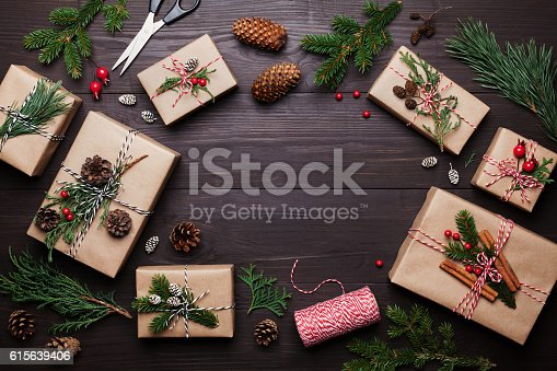 istock Gift or present box with christmas decoration. Flat lay style. 615639406