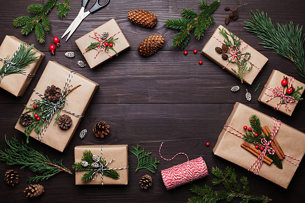gift or present box with christmas decoration. flat lay style. - handgemachte geschenke stock-fotos und bilder