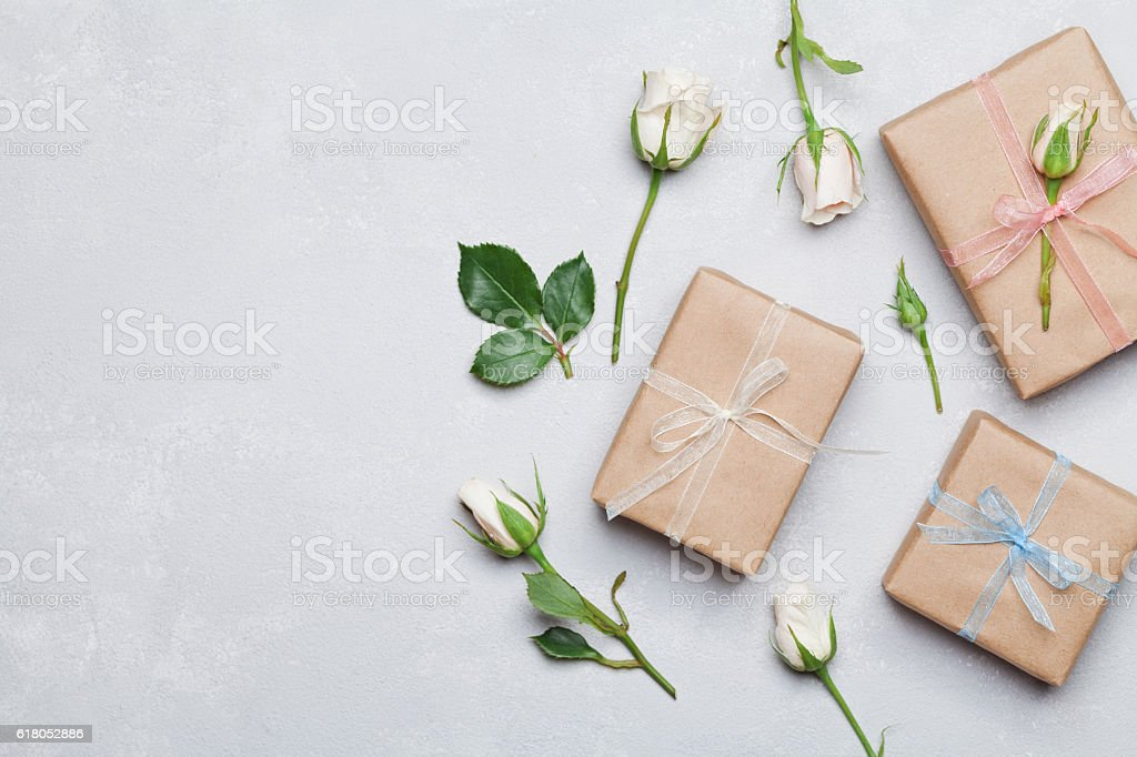 Gift or present decorated rose flowers. Holiday concept. Flat lay. stock photo